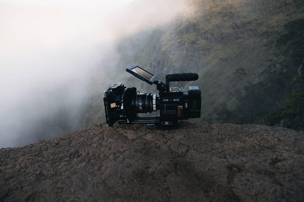 black video camera on rock